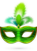 Green carnival mask with feathers — Stock Vector