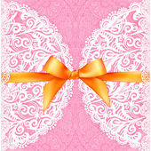 Pink lacy wedding card with orange silky bow — Stockvector