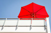 Red sunshade — Stock Photo