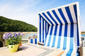 Hooded beach chairs — Stock Photo