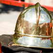 Old firefighter's helmet - Stock Photo