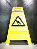 Caution slippery surface sign — Stock Photo
