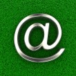 Email symbol on grass — Stock Photo #30060641