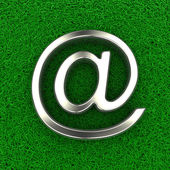 Email symbol on grass — Stock Photo