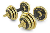 Golden dumbells isolated on white background — Photo