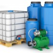 Stock Photo: Group of plastic water tanks and pumping station