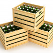 Wooden boxes with green beer bottles. — Stock Photo #46333965