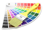 Palette of paint samples and paintbrush — Stock Photo
