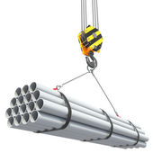 Crane hook lifts group of pipes. — Stock Photo