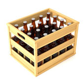 Bottles in wooden crate — Stock Photo