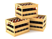 Bottles in wooden crates — Stock Photo