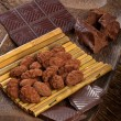Cocoa beans, dark chocolate and chocolate truffles - Stock Photo