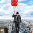 Businessman flying high — Stock Photo #14765647