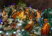 Christmas crib with figures and nativity — Stock Photo