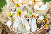 Jute wedding gifts with sunflowers — Stock Photo