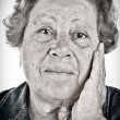 Face of an old woman - black and white portrait with dragan effe — Stock Photo