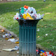 Trash basket full in park — Foto Stock