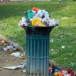 Trash basket full in park - Stock Photo