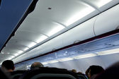Inside an airplane with passengers — Stock Photo