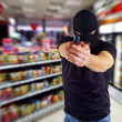 Stock Photo: Robber with masked