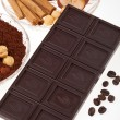 Coffee chocolate, coffee beans, cinnamon, orange — Stock Photo