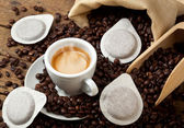 Coffee cups with pods — Stock Photo