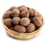 Wicker basket with walnuts — Stock Photo #23329046