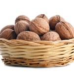 Wicker basket with walnuts — Stock Photo #23329112