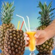Pineapple and juice glass — Stock Photo #23837135