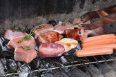 Barbecue grill with chicken and meat — Stock Photo