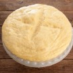 Rising Yeast Dough in bowl — Stock Photo