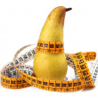 Pear measured the meter - Stock Photo