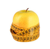 Diet concept with green apple wrapped with measuring tape — Stock Photo