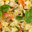 Pasta salad with tuna and cherry tomatoes - Stock Photo