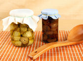 Jars with artichokes and onions in oil — Stock Photo