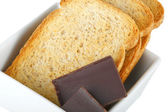 Chunks chocolate with crispbread — Stock Photo