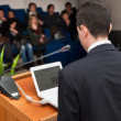 Business people group at meeting seminar presentation - Stock Photo
