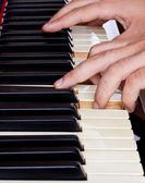 Piano keyboard made of ivory with hands — Stock Photo