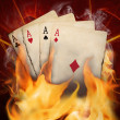 Poker cards burn in the fire - Stock Photo