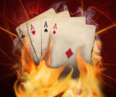 Poker cards burn in the fire — Stock Photo