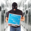 Hacker with balaclava — Stock Photo