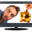 Wow expression in the tv with piggy bank — Stock Photo
