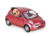 Vaya expresión de un niño en el auto rojo — Foto de Stock