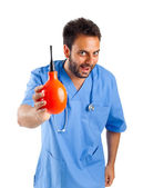 Male nurse with clyster — Stock Photo