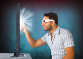 Man Wearing 3d Glasses touches the tv — Stock Photo