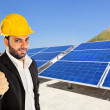 Businessman with solar panel — Stock Photo
