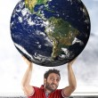 Man sustains the planet on his shoulders - Elements of this imag — Stock Photo