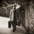 Stock Photo: Emigrant with suitcases