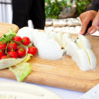 Stock Photo: Sliced of mozzarellon wooden plate