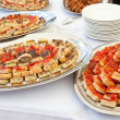 Trays with pieces of tomato pizza, omelets and rustic — Stock Photo